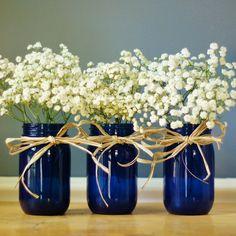 simple and pretty, I love baby's breath in a mason jar!