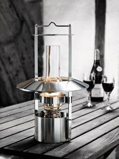 The Stelton Lamp, created in 1990 by Copenhagen-born designer Erik Magnussen for Stelton, is $689 for the 17-inch lamp from Horne. Nautical Lanterns, Office Lamp, Kerosene Lamp, Oil Lamps, Danish Design, Outdoor Lighting, Lighting Design, Lamp Design, Glass