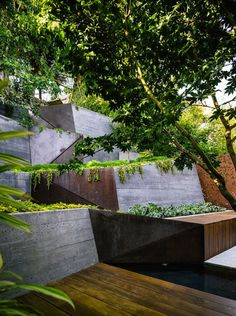 The weathering steel screens on either side of the garden are for privacy.