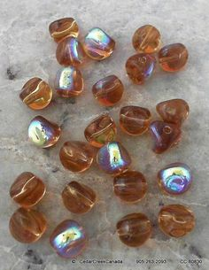 REDUCED  Iridescent Medium Topaz 9mm Twisted by CedarCreekCanada