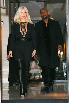 Kim Kardashian and her hubby Kanye West. Kim's stepping out in Givenchy booties. Around $2995.