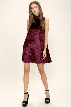 Your life of luxury starts with the Dream of Decadence Burgundy Velvet Swing Dress! From a mock neck, dreamy crushed velvet falls to a sleeveless bodice, and chic, swing silhouette. Back keyhole has two top button closures.