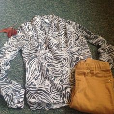 Zebra wrap blouse Sheer but has a white built in tank underneath. Wraps across the front of the body. No visible signs of damage. Price is firm but I can do bundles at discounts ! H&M Tops Blouses