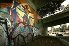 Whitewashed without Notice, Judy Baca's Iconic Freeway Mural Is Being Fully Restored 4th Street, Marathon Runners, Street Artists, Public Art, Artist Art, Graffiti, Restoration, The Incredibles, City