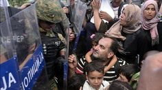 Migrants try to charge Macedonian police lines at Greek border | World news | The Guardian