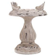 Classic-inspired birdbath with a pedestal base and antiqued finish.  Product: BirdbathConstruction Material: Fib...