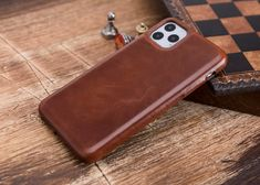 Welcome to the shop. Free shipping to all the world The product is 100% Genuine Leather. The color of the product is brown. This wallet case fit for iPhone 11, iPhone 11 Pro, iPhone 11 Pro Max Handmade phone case is made of premium quality genuine leather. Customizable letter insertion and Iphone Wallet Case, Iphone Cases, Handmade Leather Wallet, Iphone 11, Brown, Letter, Free Shipping, Etsy, Fit