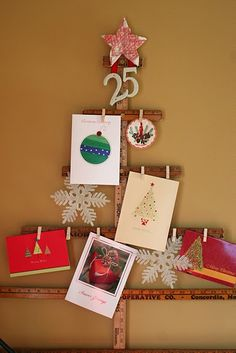 Excellent use of a yardstick for Christmas cards, but could use a simialr idea for photos on a wall...
