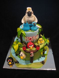 Angry Birds/ Rio Cake - Cake I recently made a fan of the Angry Birds/ Rio game. All characters are hand sculpted out of gumpaste. Accents out of gumpaste and fondant. Double chocolate cake with fresh strawberries and vanilla whipped filling.  This is definitely my favorite cake I've made thus far. Was very hard to part with this one. Thanks for looking.