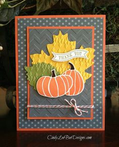 Autumn leaves with pumpkins