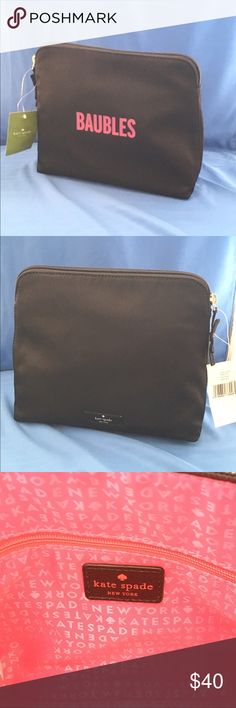 """Kate Spade """"Baubles"""" Pouch This is a black nylon Kate Spade pouch. It is called a jewelry pouch but it can be used as a cosmetic case. The inside is hot pink. I never used it and the tags are still on it. 9L x 8H x 3D. kate spade Bags Cosmetic Bags & Cases"""