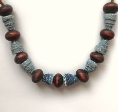 If you have small pieces of old jeans left, you can make beads out of them. Denim beads go well with wood beads and leather cord. Using jeans of different colors, you will get multi-colored denim beads. Old Jeans, Jean Crafts, Beaded Necklace, Beaded Bracelets, Fabric Jewelry, Colored Denim, Wooden Beads, Leather Cord, Different Colors
