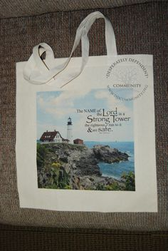 The name of the Lord is a Strong Tower...Prov 18:10  tote created using Digital File by DesignVerses on Etsy overlaid on original photography of Portland Head Lighthouse.