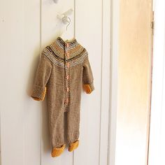 For our next niece or nephew due in December?  Ravelry: ZZZ-jumpsuit pattern by Anna & Heidi Pickles