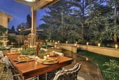 Mediterranean Patio with Fence, exterior stone floors, Royal Lion Fountain, Pathway, Raised beds, Fire pit, Fountain