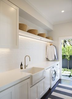 laundry room design, white laundry room with laundry room storage, laundry room organization with neutral floor tile, neutral mudroom design with laundry and folding counter and laundry sink Laundry Decor, Laundry Room Organization, Laundry Room Design, Laundry In Bathroom, Laundry Storage, Laundry Closet, Laundry Cupboard, Bathroom Box, Basement Laundry