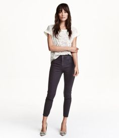 Pants in washed stretch twill with a regular waist and slim legs. Side pockets, decorative seams on legs, and zips at hems.