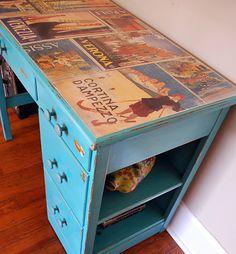 turquoise desk decorated w/ an italian calendar