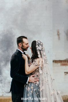 Your veil doesn't have to be the focal point of your big-day ensemble to make a statement. Take this bride's unique look, for example. We love how the romantic pink flowers throughout her veil referenced the same-colored appliqués on her gray-blue wedding dress. The result? A completely cohesive getup, from head to toe. #weddingideas #wedding #marthstewartwedding #weddingplanning #weddingchecklist Star Wedding, Mod Wedding, Wedding Veils, Bridal Veils, Garden Wedding, Birch Wedding, Wedding Disney, Wedding Posing, Wedding Altars