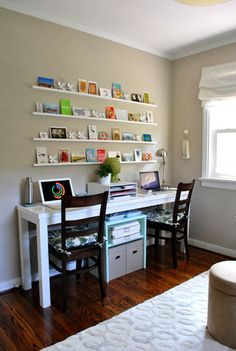 LOVE this small office set up for 2! Plus the changeable wall art is pretty cool.