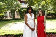 Pin for Later: If You Don't Already Own a Red Dress, Allow Queen Letizia to Show You Why You Should The Bright Color Stood Out Against Michelle's LWD We also love her drop earrings!