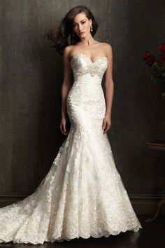9051 | Allure Bridal | A gorgeous fit and flare gown. The fitted bodice has a sweetheart neckline that is embellished with Swarovski crystals. The entire design is adorned with delicate lace appliqué on English net.    Gown available in White/Silver, Ivory/Silver, Ivory/Gold/Silver    Available at GatewayBridal.com or in Store in Salt Lake City, Utah