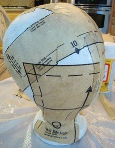 Transform a blah styrofoam wig head by attaching vintage old dress patterns to create a hat or jewelry store display or home decor.  For ideas and goods shop at Estate ReSale & ReDesign in Bonita Springs, FL