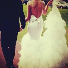 Backless Wedding Dress Gown - What dreams are made of! A backless mermaid-style wedding dress with bow-detail is striking!