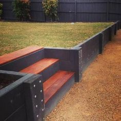 A retaining wall is a perfect DIY project for a variety of skill levels. We have rounded several retaining wall ideas to decorate and build your landscape. Concrete Sleeper Retaining Walls, Wooden Retaining Wall, Cheap Retaining Wall, Retaining Wall Steps, Backyard Retaining Walls, Building A Retaining Wall, Sloped Backyard, Sloped Garden, Backyard Landscaping