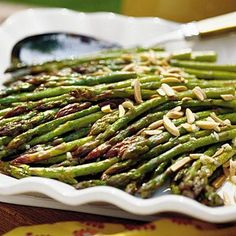 Oven-Roasted Asparagus | Top oven-roasted asparagus with slivers of toasted almonds for a quick and easy side dish. | SouthernLiving.com