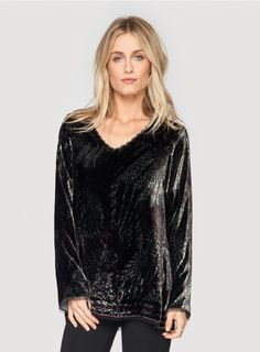 Rumble V-Neck Tunic The Rumble V-Neck Tunic, done in our signature luxurious silk velvet lazer printed with a radiant geometric pattern, is one-of-a-kind. This printed velvet tunic features luxe detailing like a scallop trim along its neckline and a delicate black netting trim along its hemline and sleeve cuffs. Channel Stevie Nicks as you pair the Rumble V-Neck Tunic with a maxi skirt and heeled booties. Features long sleeves and a relaxed fit.  -Silk Velvet -Relaxed Fit -V-Neck and Long…
