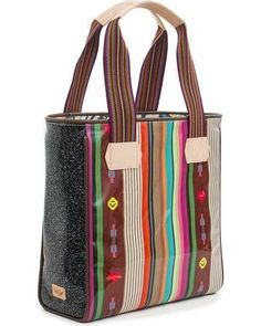 e934230ec652 A classic tote by Consuela with a gorgeous striped pattern and woven  handles. Complete with
