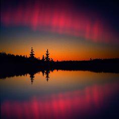 Setting Sun. Aurora Borealis.
