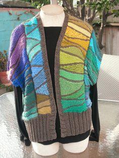 Kalaidascope swing knitting done in columns using color gradation.