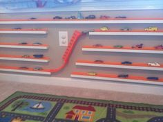 Hotwheels display. Wood blocks with track and car shoot added.