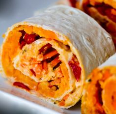 Sweet Potato Glow Spirals (Vegan) -- One of my favorite vegan dishes. Sweet Potato Wrap, Sweet Potato Rolls, Sweet Potato Hummus, Sweet Potato Recipes, Enchiladas, Clean Eating Recipes, Cooking Recipes, Healthy Eating, Pork Recipes
