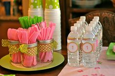 Decorative Way to display plasticware  Source: partyplanningmom.blogspot.com via Mandi on Pinterest  See those amazing streamers overhead? They are $1 tablecloths from the Dollar Store. What a big statement for so little money!