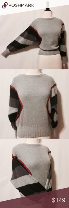 """Louis Feraud Vintage Gray Cashmere Sweater Sz M Amazingly beautiful! Gray, charcoal, black knitted cashmere with ruby ribbon accent. Sleeves are knitted in alternating colors to add more drama to this beautiful sweater. Round neckline, two piece constitution with wide ribbed hemline. Made in Germany Dry Clean Only 42"""" Chest 22"""" Overall length #TH1102014 Louis Feraud Sweaters Crew & Scoop Necks"""