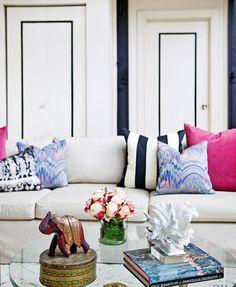 white, navy, raspberry color living room