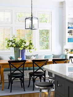 A narrow table is a perfect fit in this short-on-space kitchen. Find more dining area ideas: http://www.bhg.com/kitchen/eat-in-kitchen/dining-room-and-eating-area-design-ideas/?socsrc=bhgpin071712smallspacebanquette#page=19