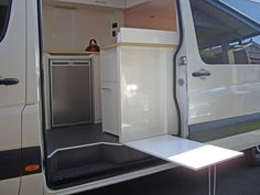 Outside table on stealth Sprinter conversion...I'm always weighing stealth vs. glamourbus antics...