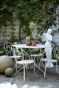 I'd like to sip a Sunday morning mimosa in the romantically shabby red chair courtyard garden in Hudson, NY Garden Furniture, Outdoor Furniture Sets, Iron Furniture, French Farmhouse Decor, Farmhouse Style, Coastal Farmhouse, Outdoor Fun, Outdoor Decor, Outdoor Entertaining