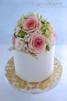 Sugar flower cake in pastell shades - roses, sweet peas, hydrangeas and berries out of gumpaste, sugarpaste