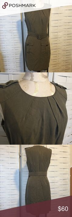 Trina Turk dress N.063 Stylish olive green dress! Excellent condition! No holes rips or stains. It has a fully functional belt that can be removed, 2 front pockets with buttons which are a little loose and a hidden zipper in the back. Fully lined.shell 100% tencel lining 100% acetate. Anthropologie Dresses