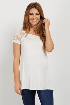 Super chic and feminine, this maternity top gives that extra something that you need. With lace accents and a solid hue, this top is versatile. Style with your favorite maternity jeans and flats for a classic look.