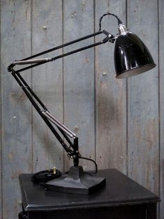 a vintage herbert terry anglepoise lamp.