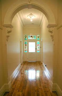 Detailed arch way with beautiful corbels, large skirts and cornices, polished pine floor boards (much prefer hardwood) - beautiful entrance Archway Molding, Archways In Homes, Arch Doorway, Entrance, Arched Doors, Architrave, Decorative Mouldings, Moldings And Trim, Home Upgrades