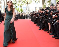 Monaco's golden girl, Charlotte Casiraghi, graces the red carpet at Cannes.  Charlotte, who is the face of Gucci's 'Forever Now' campaign wears, of course -- Gucci. The forest green gown featured ruffles cascading down the skirt and around the neckline and was teamed with a black and gold clutch and gold peep-toes.