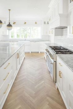 White kitchen with herringbone wood floor by The Fox Group. Come be inspired by 11 White Kitchen Design Ideas Adding Warmth! White kitchen with herringbone wood floor by The Fox Group. Come be inspired by 11 White Kitchen Design Ideas Adding Warmth! Home Decor Kitchen, Interior Design Kitchen, Home Kitchens, Kitchen Hacks, Dream Kitchens, Beautiful Kitchens, White Interior Design, Beach House Kitchens, House Kitchen Design
