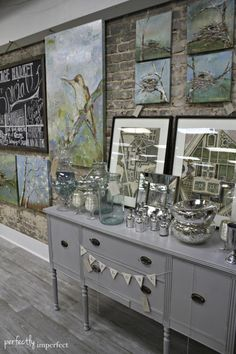 I love the grey buffet and wine bottle lamp from perfectly imperfect Vintage Store, Vintage Market, Visual Merchandising, Display Design, Display Ideas, Visual Display, Booth Ideas, Store Design, Shop Displays